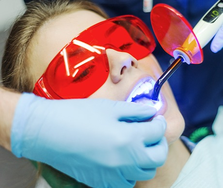 Patient receiving dental bonding